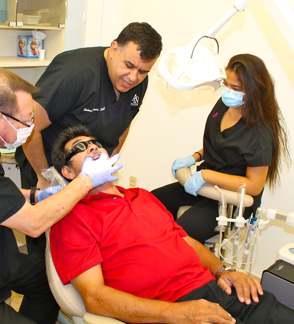 Dentist Farshad examines patient